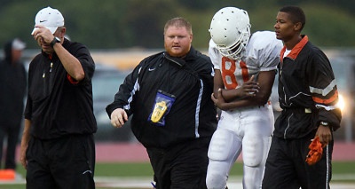 Big man on campus: New trainer plans sports medicine program