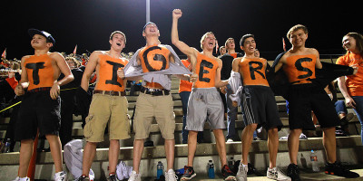 Shirtless spirit: Swim team tries to bring life to student section