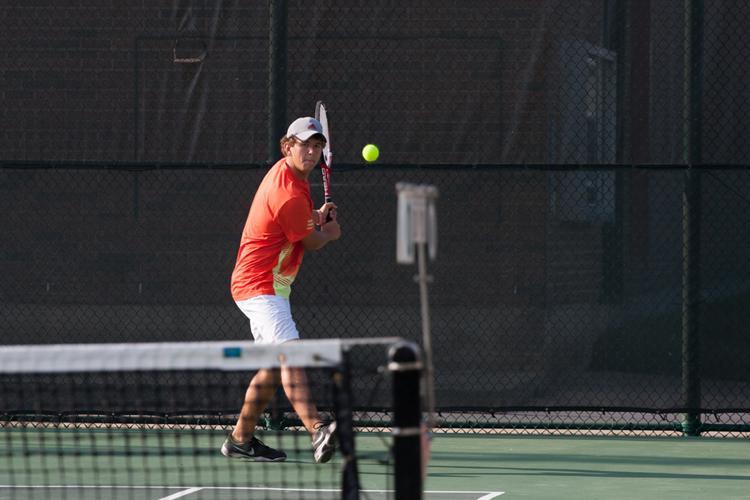 Tennis team wins district opener