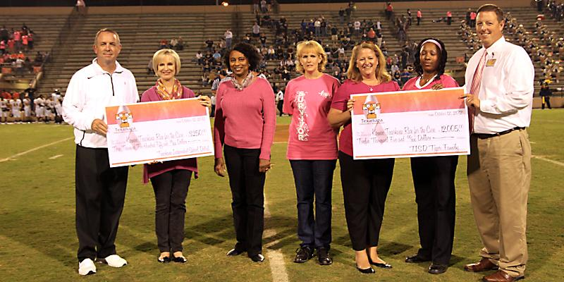Pink Out: District presents check to Komen representatives