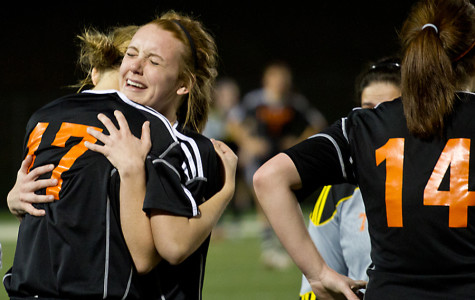 After losing to Mabank, 1-2, in overtime, senior Riley Rogers hugs her teammate, senior Natalie Copeland, before exiting the field.