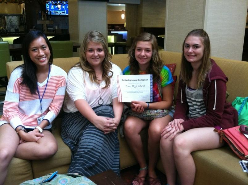 Yearbook editors Chau Dong, Maegan Jordan, Morgan Williams and Katelyn Markham display their yearbook award.