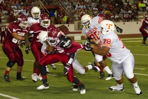 Texas High defenders take down the opposing running back during Friday's rivalry game.