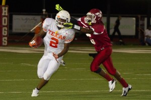 Attempting to escape a tackle, senior Treveon Walker carries the ball down field.