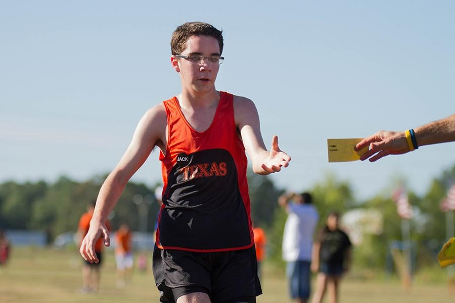 Freshman+cross+country+runner+Jonathan+Rowland+completes+one+of+his+first+high+school+meets.