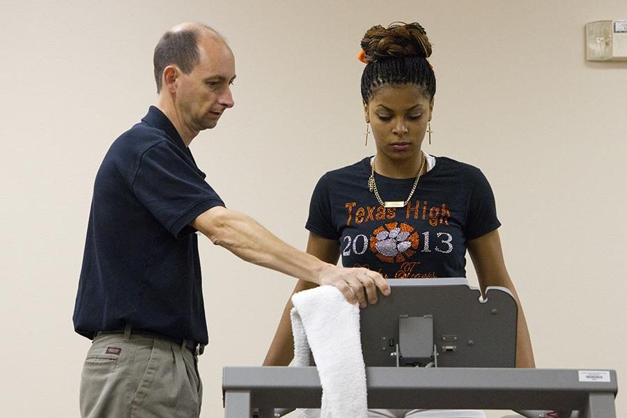 Working with her physical therapist, junior Chanell Hayes recovers from a torn ACL.