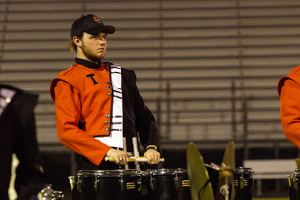 On the field, senior Bradley Baird performs at the Fire Ant Classic. The band won the competition for the second year in a row.