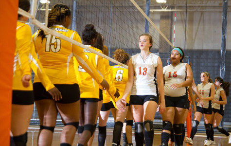 Sophomore Taylor Post congratulates the Mount Pleasant volleyball team after the game.