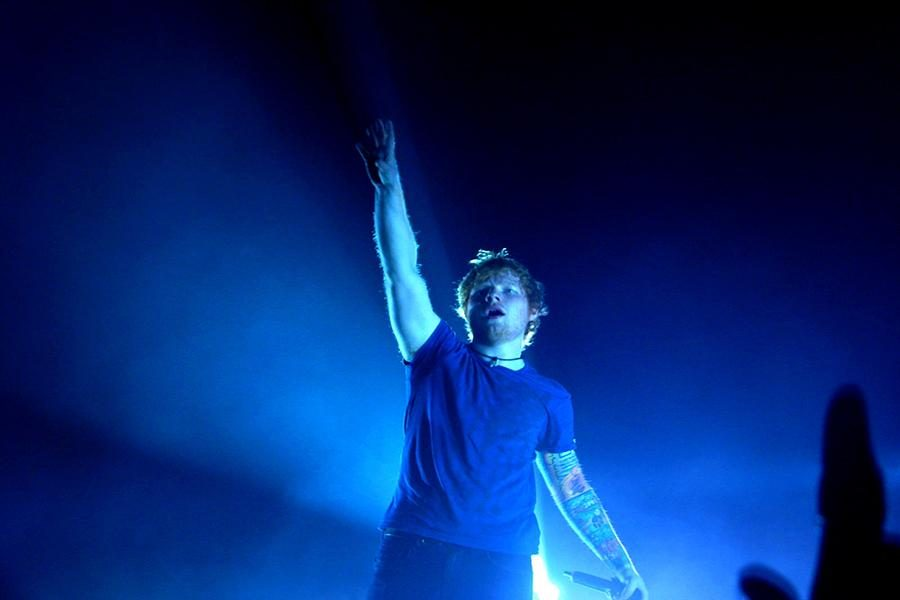 Singer-songwriter+Ed+Sheeran+performs+for+his+fans%2C+many+of+whom+show+their+gratitude+by+%22following%22+him+on+Twitter.