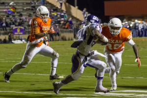 During a play, seniors Anthony Rhone (8) and Marquan Daniels (22) hunt down the opposing running back.