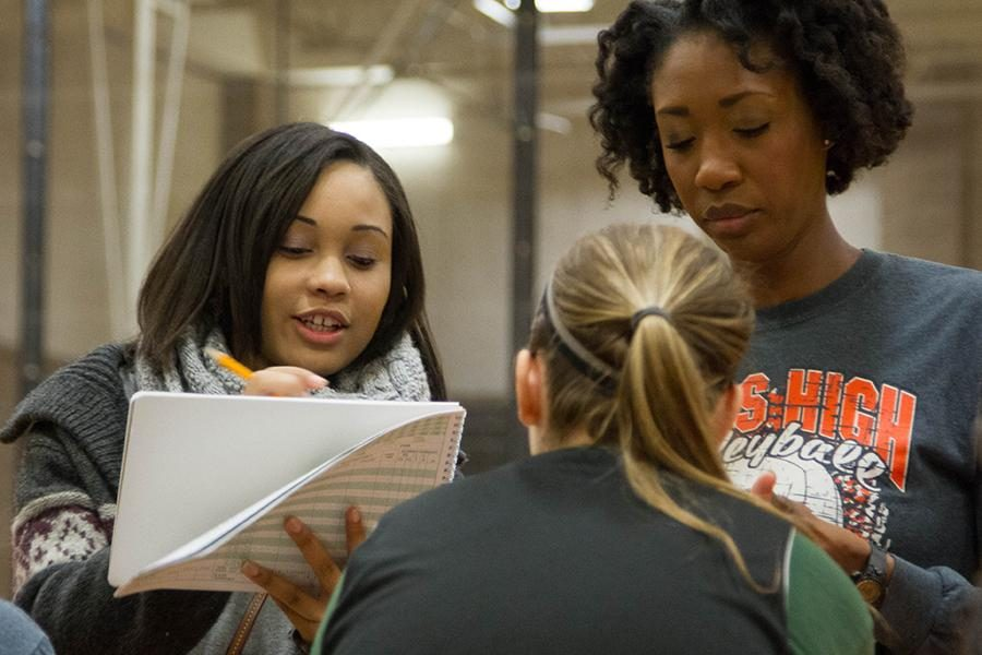 Manager of the basketball team, senior Chelse Williams, works on the score book for the team.