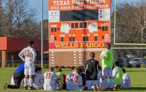 Boys' varsity soccer team reflects during their game against Henderson.