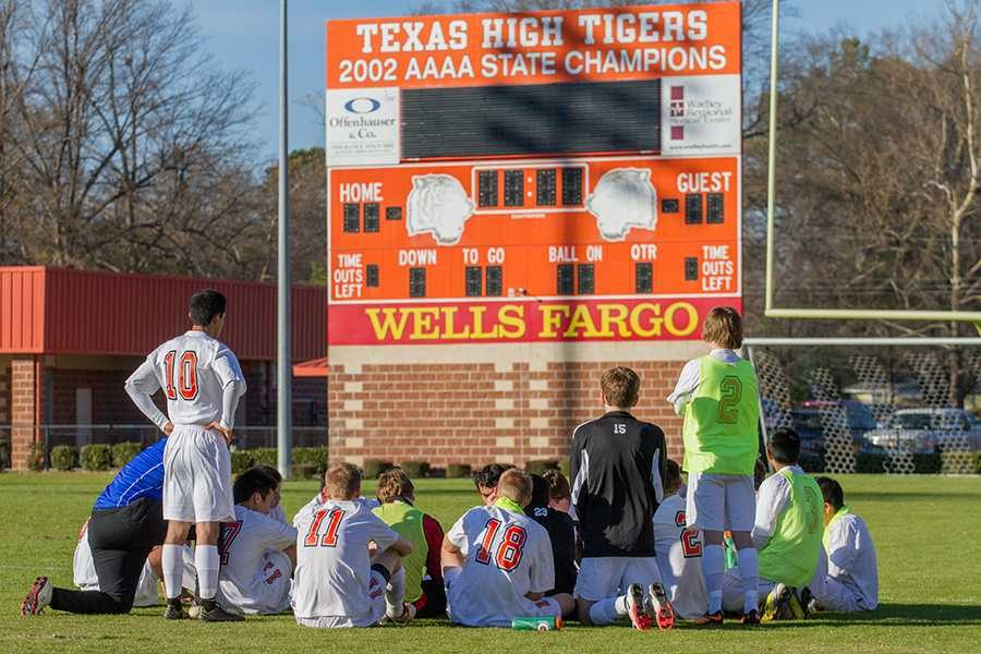 Boys%27+varsity+soccer+team+reflects+during+their+game+against+Henderson.