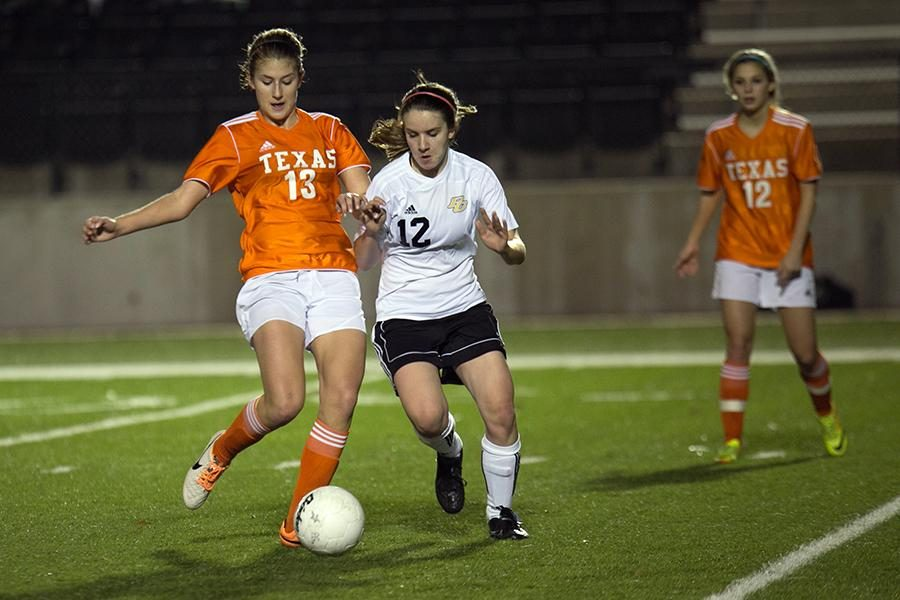 Junior Hannah Brantley tries to save the ball as a PG defender tries to take it during the game Tuesday. The girls lost 2-0.