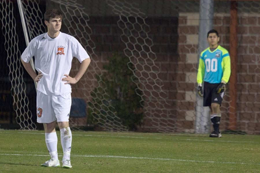 Senior Alex Frederick looks on as the offense struggles to maintain control of the ball.