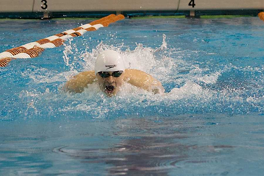 Senior Chris Radomski swims the 100-yard butterfly at the state meet in Austin. He won the gold medal in the event.