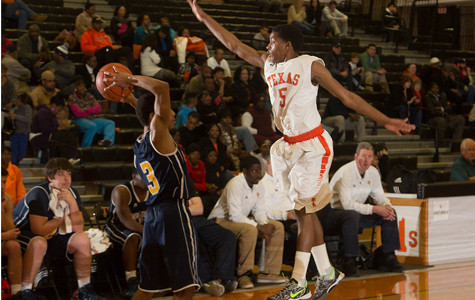 Senior Darion Kidd defends a pass during the boys' win against Pine Tree.