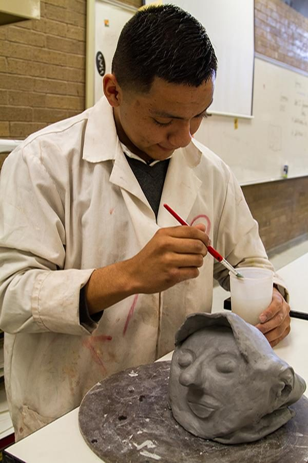 Student works on sculpture during art class