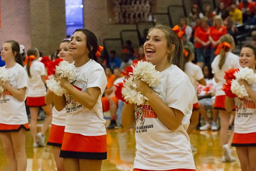 Sophomore Jayci Pettigrew cheers at a pep rally.