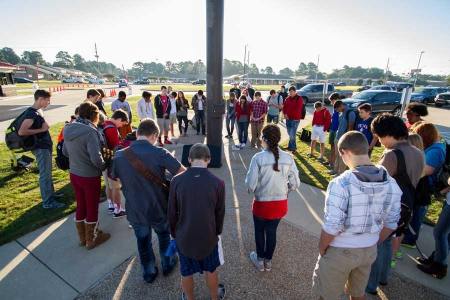 Students gather around the flagpole for the annual See You at the Pole event.