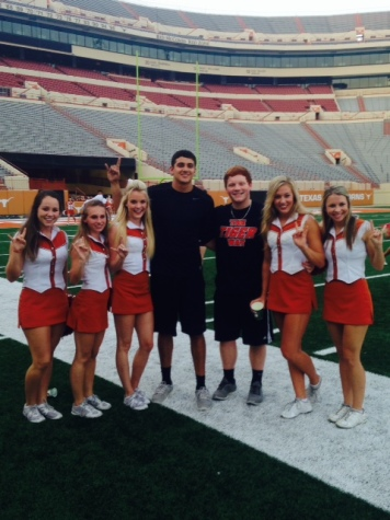 Seniors Gage Martin and Aaron Sesler pose with some University of Texas cheerleaders