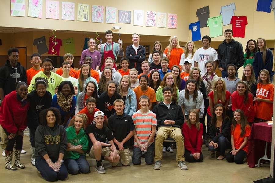 Student council volunteers pose after hard work