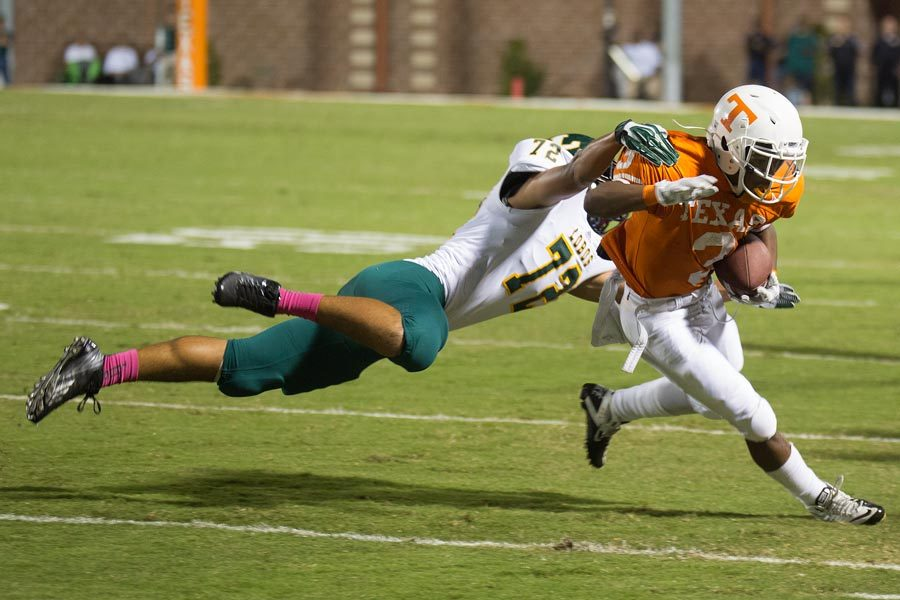 Texas High's Jakardi Witcher is tackled from behind while trying to turn the corner on a sweep play. Texas High lost to Longview 20-38.