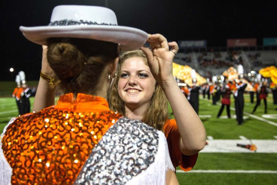 Olivia Johnson ensures that the small details of a Highstepper's uniform is in place before the team's halftime performance.