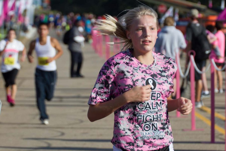 Freshman cross country runner Ryann Williams crosses the finish line at the 16th Annual Susan G. Komen Race for the Cure. Many Texas High students participated as participants and volunteers.