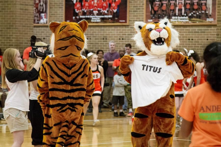 The new mascot flaunts shirt that reveals new name voted on by the student body at pep rally