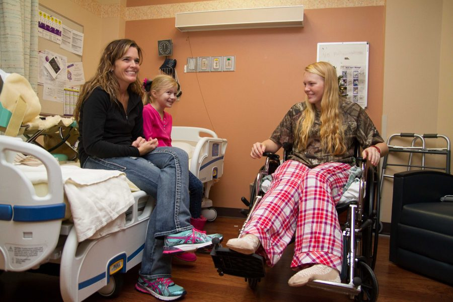 Madison+Winchell+sits+with+family+in+her+room+in+the+rehab+facility+at+St.+Michaels+Hospital