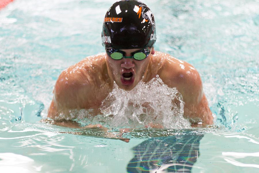 Junior Luke Calhoon competes in the breast stroke during the Orange and White Swim Meet held at the Pinkerton Center on the campus of Texarkana College.