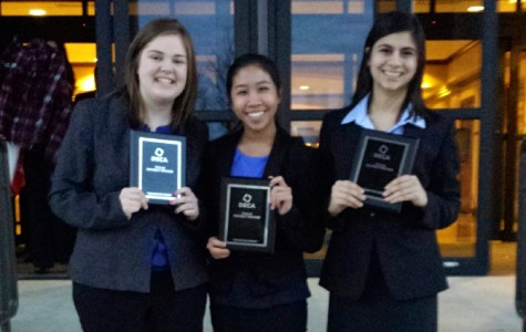 Juniors Colleen Russell, Alana Tran and Naveen Malik smile after being awarded in DECA competition. Photo by club sponsor