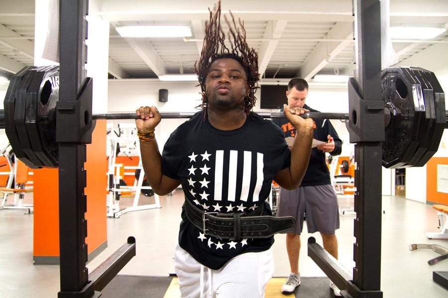 Senior Makel Henderson practices squats at powerlifting for upcoming meets.