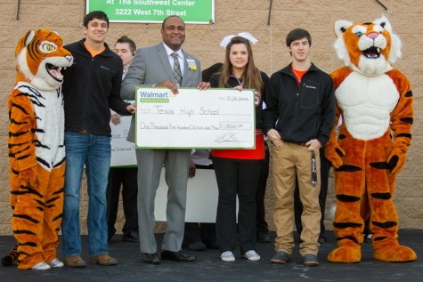 Gage Martin, store manager Anthony Porchia, Katie Johnston and Garett McDonald pose with grant given by the Neighborhood Market Walmart at store grand opening.