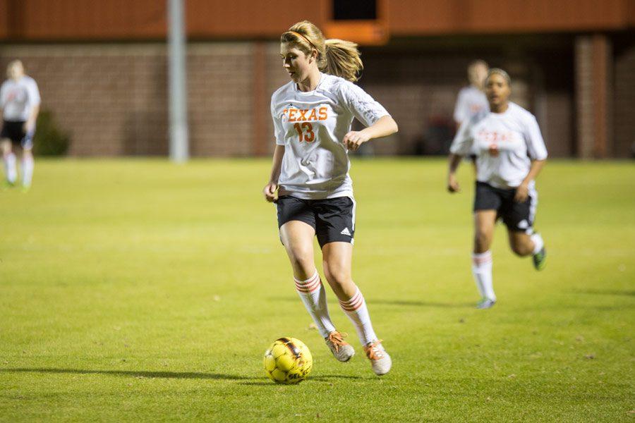 Senior Hannah Brantley dribbles ball down to score.