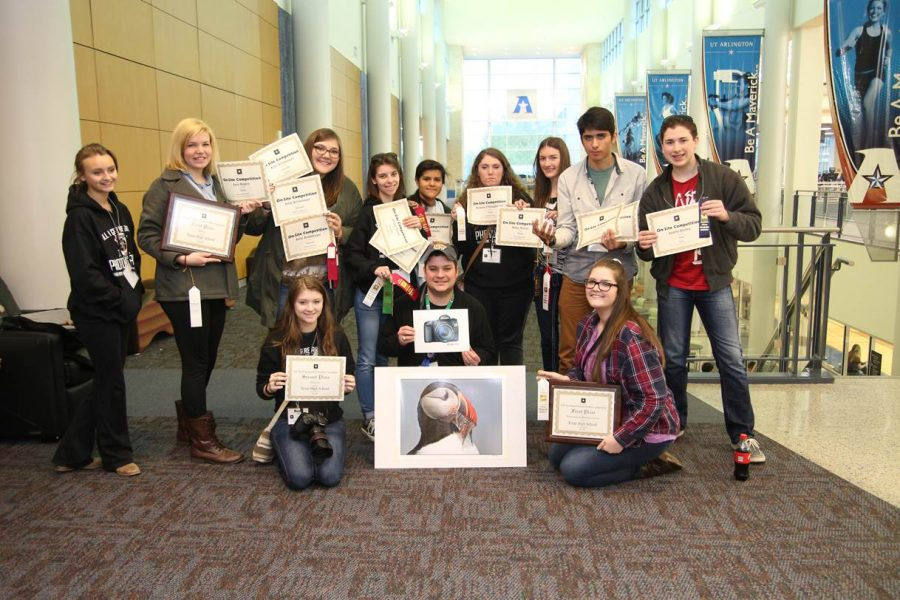 Photography students pose with awards from ATPI contest.