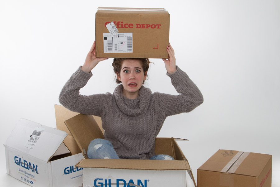 Sophomore Grace Hickey sits flustered in the mounds of boxes and stress that come with moving.
