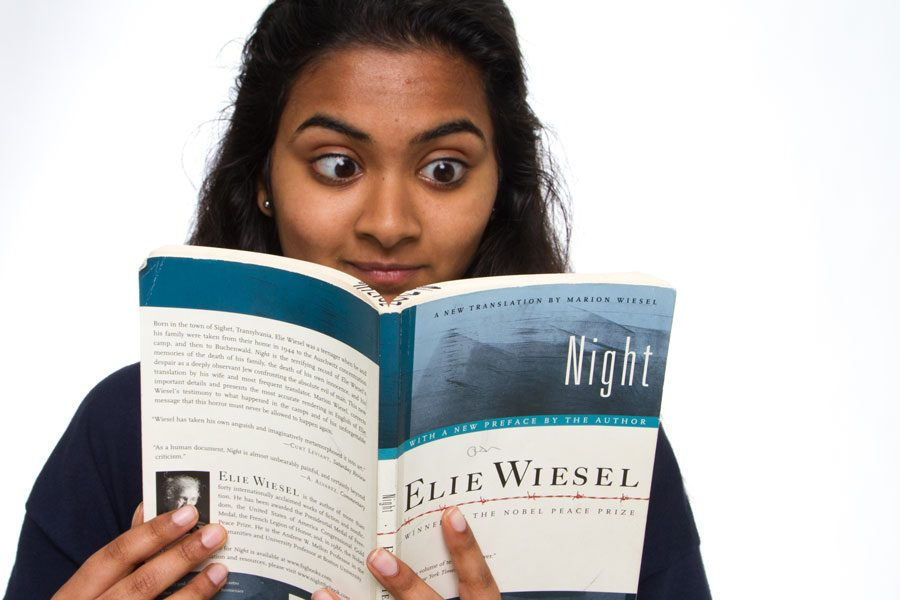 Sophomore+Raga+Justin+pictured+reading+book+%22Night%22+by+Elie+Wiesel.