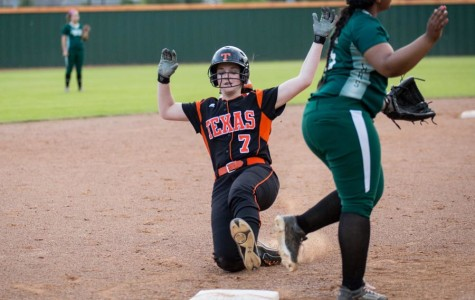 Sophomore Braley Turner slides into third during the Longview game.