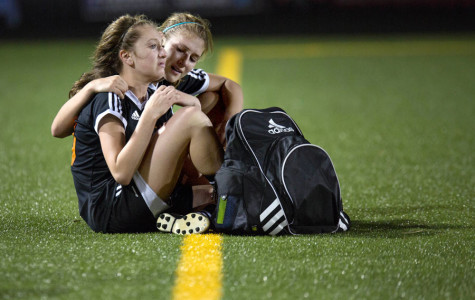 Senior Hannah Brantley tries to comfort freshman Brylee Bender after a 1-5 loss against the Lake Ridge Eagles in the AAAA Girls Soccer Playoff game in Tyler, TX. The loss ended the Lady Tiger's season with a record of 20 wins and only four losses.