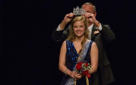 Senior Katherine Doan receiving her crown from Principal Brad Bailey.