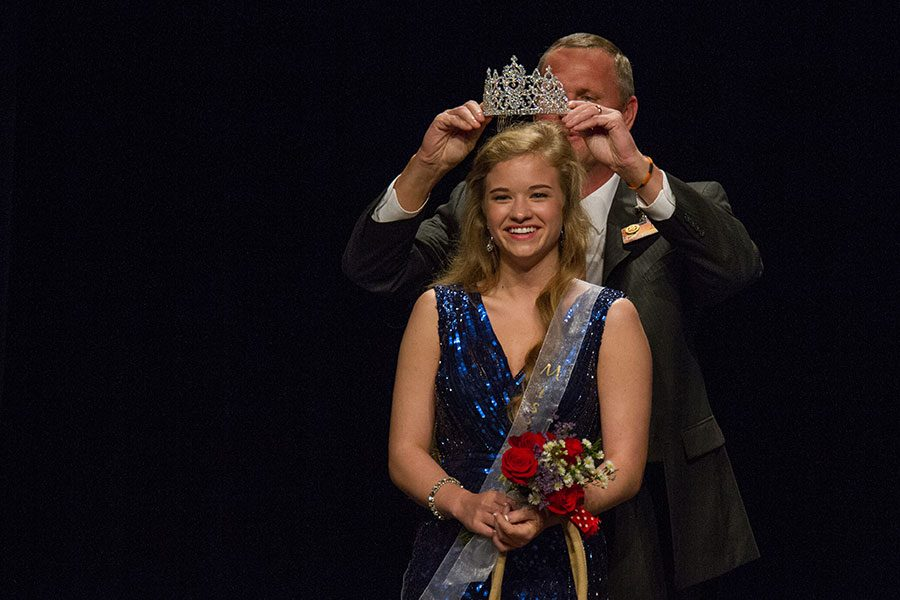 Senior Katherine Doan receiving her crown from Principal Brad Bailey.