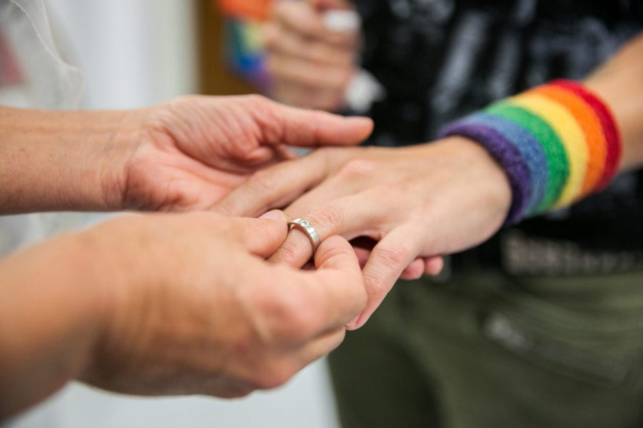 Natalie Novoa has her wedding ring put on by Eddie Daniels, left, as the couple marry during a ceremony at the L.A. County Registrar office in Beverly Hills, Calif., on Friday, June 26, 2015. The couple have been together for the past 11 years and have been waiting to wed this auspicious day in which the U.S. Supreme Court ruled that same-sex couples have a constitutional right to marriage