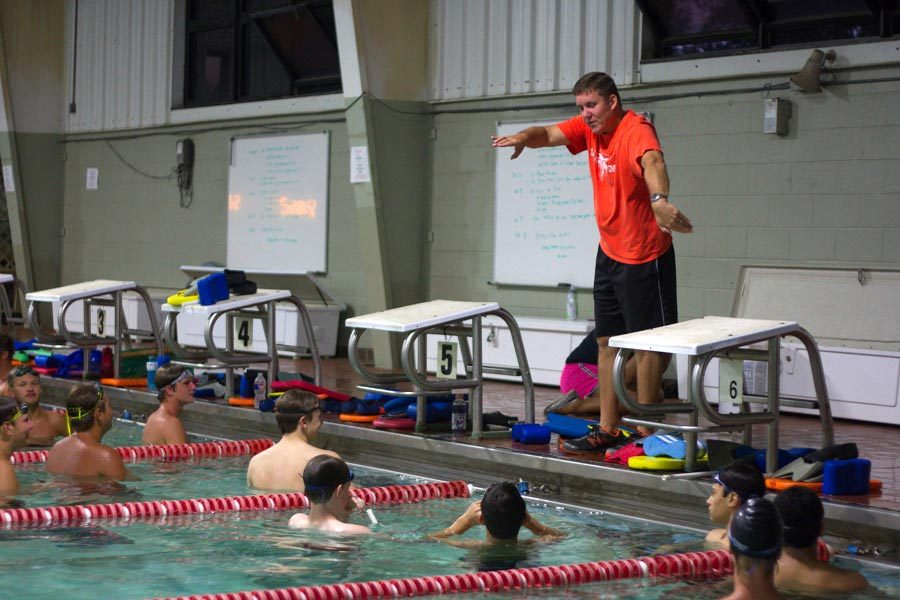 Coach Carl Auel demonstrates freestyle for the team. Auel announced his resignation on Aug. 21. File Photo