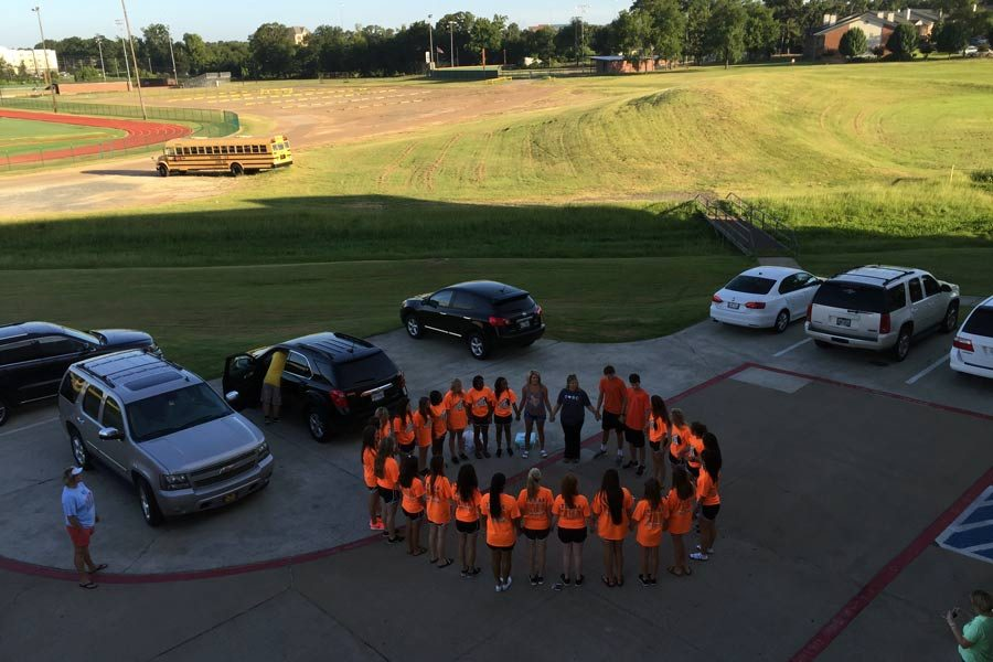 The cheerleaders pray for a successful run at the University of Texas cheer camp.  Submitted Photo.