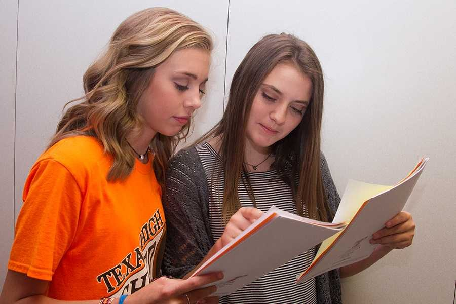 Freshmen Elaina Robertson and Allison Yancey compare schedules during Tiger Camp.