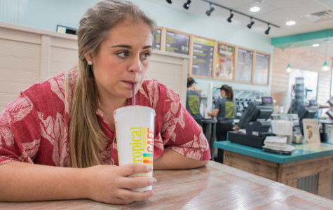 Senior Jessica Emerson enjoys a smoothie at Tropical Smoothie Cafe. The cafe held its grand opening on Aug. 14.
