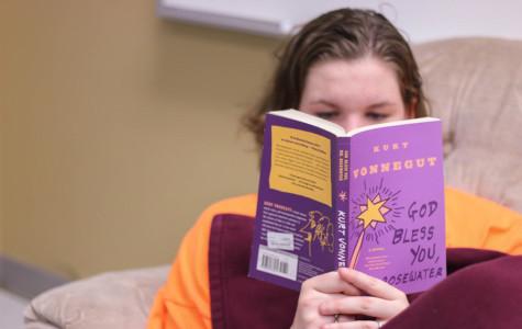 Junior Katie Dusek enjoys a  Kurt Vonnegut novel.