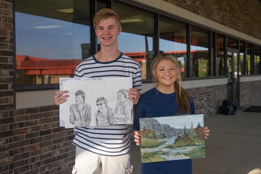 Colton Johnston and Jera Davis display their artwork that will be featured in Texas Congressman John Ratcliffe's office.